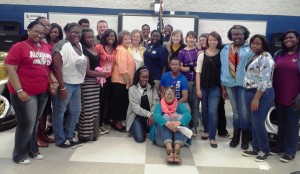 Fran Bishop with band members and school faculty together at Lee High School.